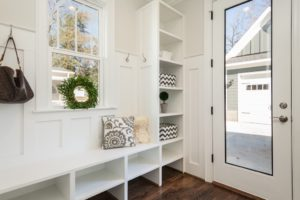 A clean home entrance with organizational units